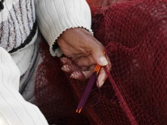 Mending the fishing nets