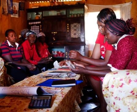 Collecting loan repayments and savings at the Kuuga Na Gwika Womens Group in Limuru.
