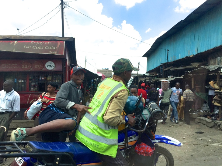 A typical boda boda. Helmets all round, of course...
