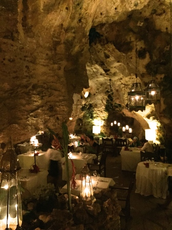 'Ali Barbour's Cave' restaurant is set deep within the coral reef limestone rock, in a cave estimated to have been formed around 150,000 years ago. It's around 10 metres deep, but parts remain open to the sky.