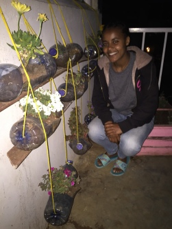 Kalkidan pulled ideas from the internet on recycling old bottles, to turn the girls' hostel balcony into a beautiful flower display